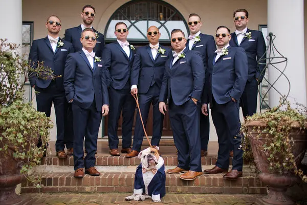 Groomsmen with a dog