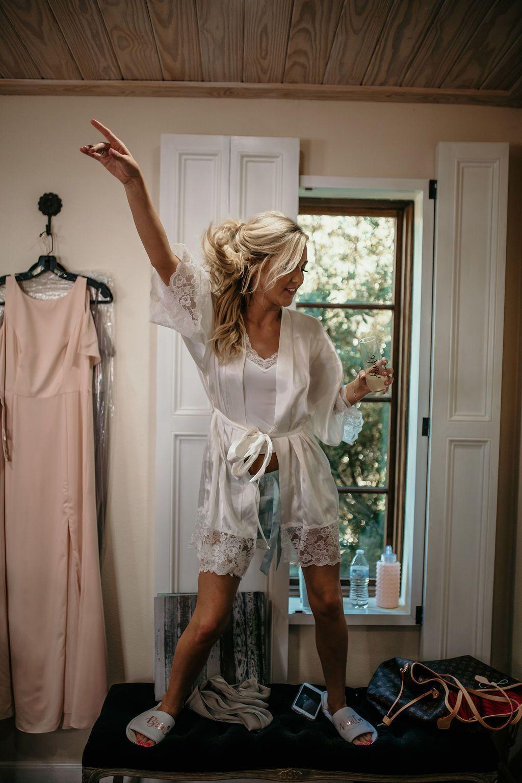 Woman dancing in a robe