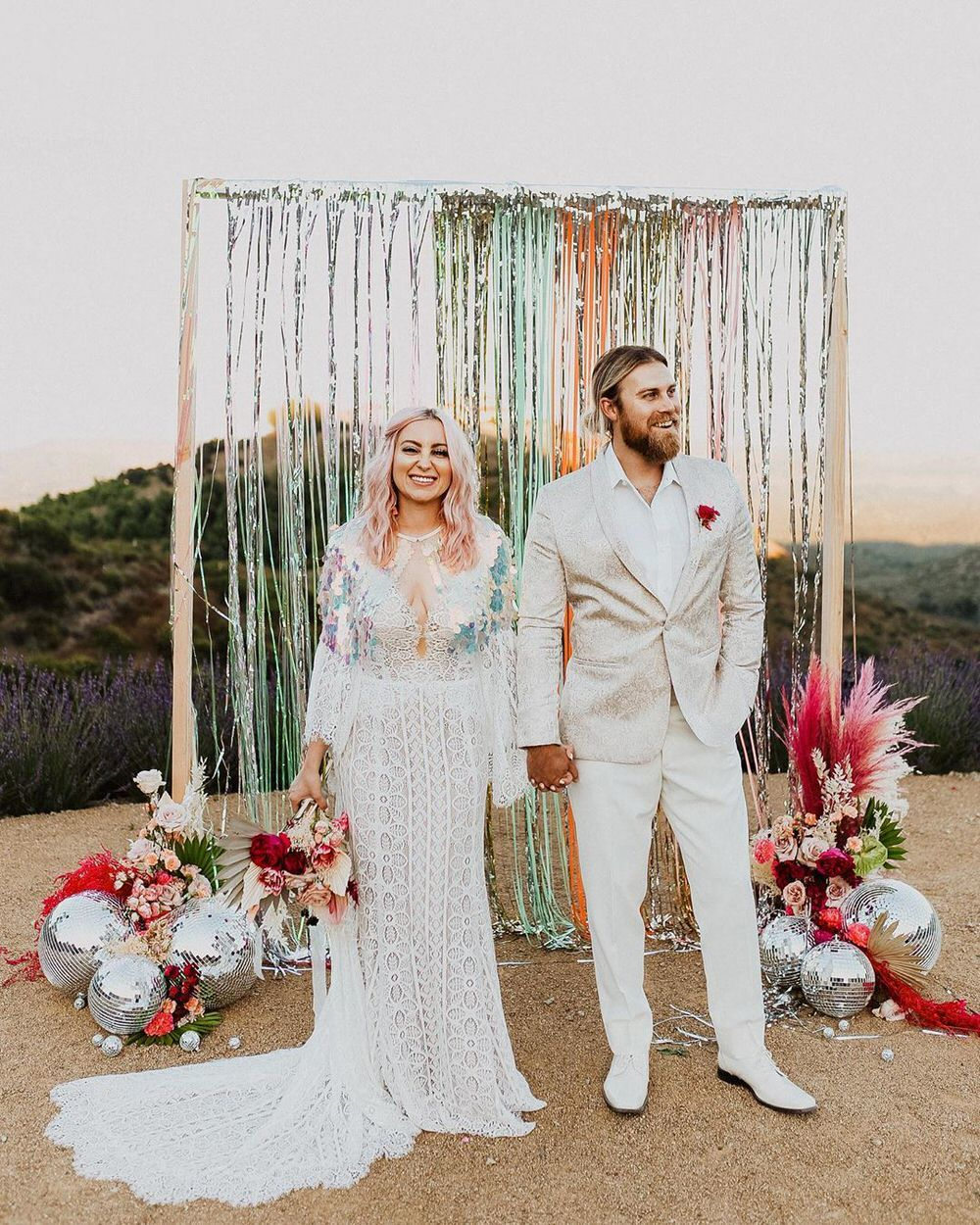 wedding alter decorated with streamers and disco balls